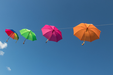 multi color umbrellas floating in Werfenweng, austria