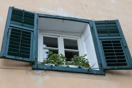old window with shutters in south tyrol