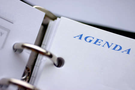 Agenda planner closeup, focus on word agenda                                                                                                                                             Stock Photo