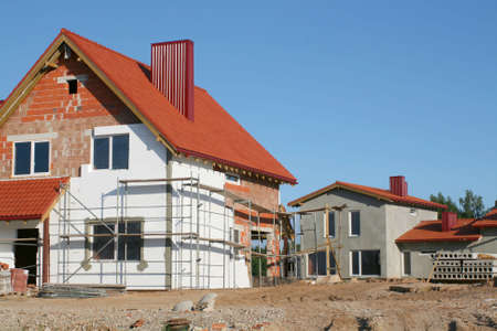 Empty new home construction site on clear summer day with blue sky Stock Photo