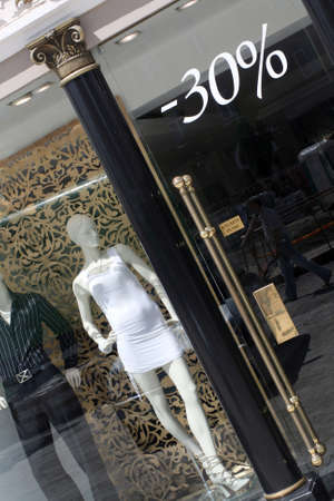 Dummies at the luxury clothing boutique window  Stok Fotoğraf