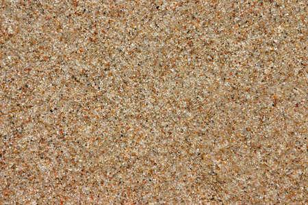 ビーチの砂の背景、自然な風合い、茶色色、コピー スペース