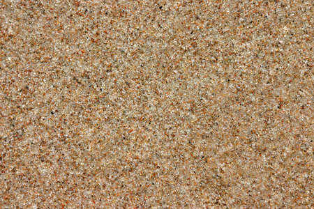 Beach sand background, natural texture, brown color, copy space