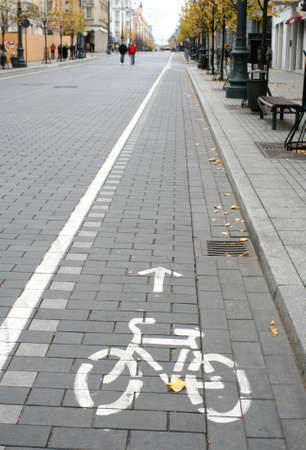 Bicycle route sign on the city road and arrow pointing direction Stock Photo