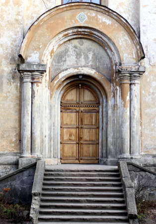 Entrance of the old church with doorsteps Stock Photo