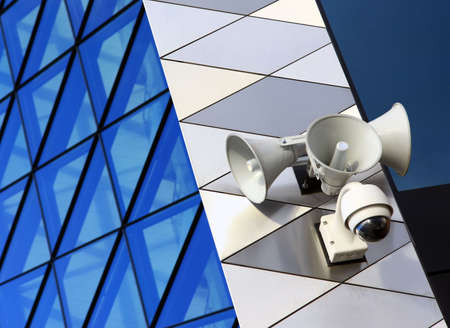 Modern security equipment placed on modern architecture building Stock Photo