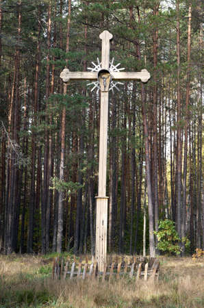 Old wooden abandoned cross in the middle of the woods Stock Photo - 11602125
