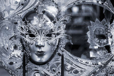 Black and white picture of traditional carnival mask in Venice, Italy