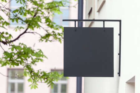 Black empty outdoor signage mockup to add company logo Banco de Imagens
