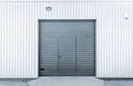 Closed modern steel garage or warehouse doors, colorized industrial picture Stock Photo