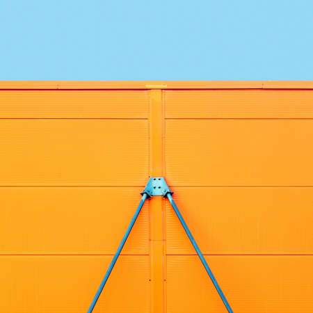 Colorful metal construction detail of industrial architecture with blue sky on the top, geometric abstract background picture