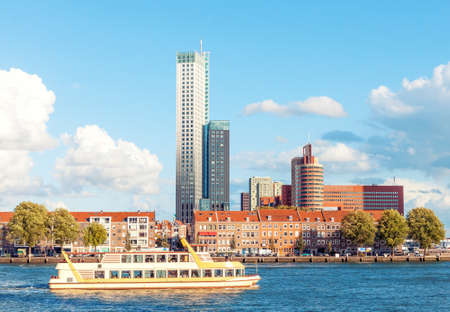 Rotterdam skyline view with tourist boat in bay and modern office buildings in the background 写真素材