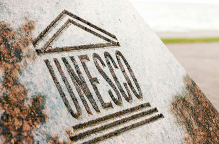 Close up of UNESCO world heritage sign carved on stone