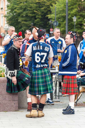 Vilnius, Lithuania - September 1, 2017: Group of middle age men, Scotland football team fans in national clothes drinking beer on the street in Vilnius, Lithuania 報道画像