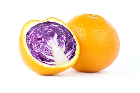 Creative photo manipulation of sliced orange with red cabbage inside isolated on white background Stock Photo