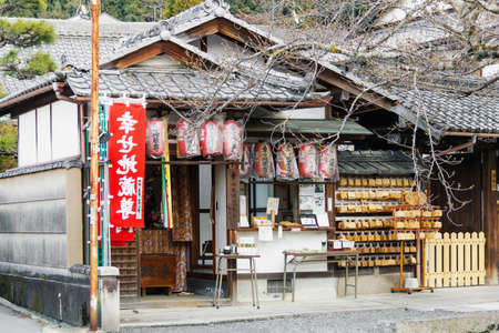 Kyoto, Japan - 26 March, 2012: Small japanese buddhist shrine entrance and facade in Kyoto, Japan. Front view, daytime picture, no people.