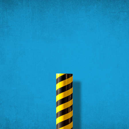 Road caution sign with diagonal yellow and black stripes against blue distressed wall. Abstract colorful minimlist picture 写真素材
