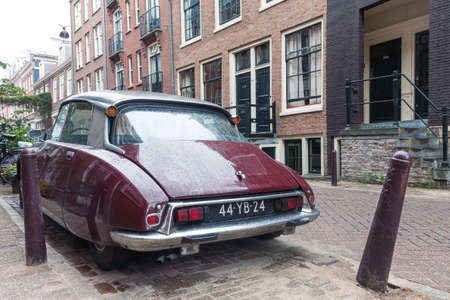 Amsterdam, Netherlands - 23 August, 2018: Retro vintage french Citroen car from behind parked on the street of the old town of Amsterdam on the rainy day in Netherlands 報道画像