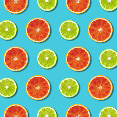 Vibrant red orange and green lime lemon slices pattern on turquoise color background. Minimal flat lay top view food texture