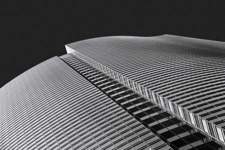 Abstract shape of modern architecture office building, low angle skyscraper view, black and white dynamic building picture 写真素材