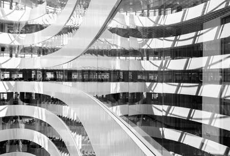 Black and white picture of abstract interior of modern business center, geometric lines and shapes background
