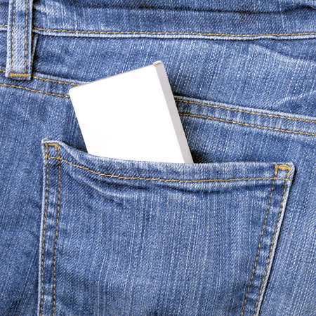Blank white box mockup with copy space to add text in the back pocket of blue jeans
