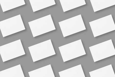 White blank horizontal business cards arranged in rows on gray solid color background, geometric business card mockup with copy space