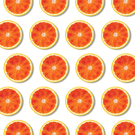 Red orange fruit slices pattern on white background. Minimal flat lay top view food texture 写真素材