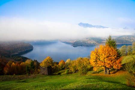 rural autumn landscape in Romanian Carpathians, Ceahlau mountain and Bicaz lake photo