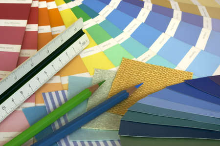 Interior Designing-Some tools for interior decorating: a paint swatch, fabric samples, colour pencils and a ruler. Stock Photo