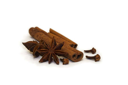 Dried Herbs And Seasonings-A close-up of cinnamon, aniseed and cloves on white background Stock Photo