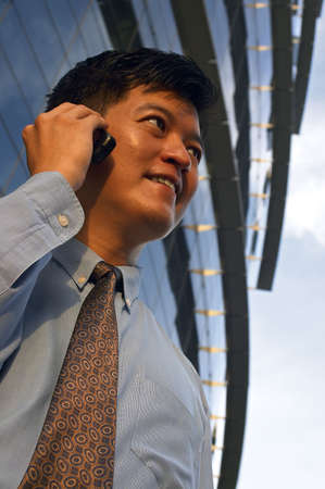 communicatio: Businessman On Cell Phone
