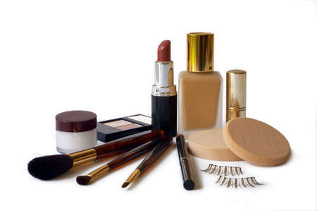 balm: Assortment of womens cosmetics -  foundation, lipstick, eyeshadow, lip liner, lip balm, applicator brushes & fake eyelashes