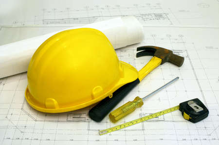 Architectural Floor Plans and Some Builders Tools - a hammer, screwdriver & measuring tape