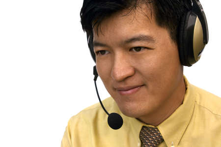 Asian Male With Headset Listening To Customer Stock Photo