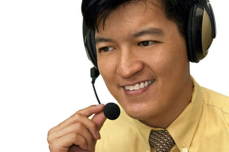 Asian Male Adjusting Headset While On The Line With Customer