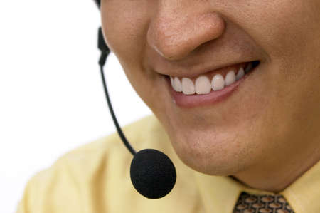 Service With A Smile - A man with a headset on the line with a customer photo