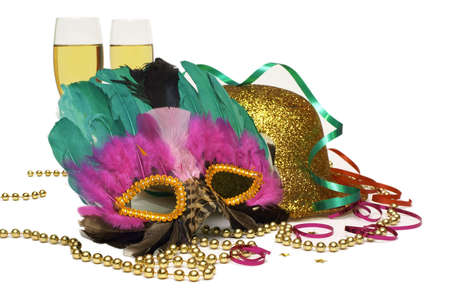 Time For A Great Party - A Mask, A Gold Glitter Hat, Gold Beads, Streamers and Two Glasses of Champagne. Isolated on White Background. Stock Photo