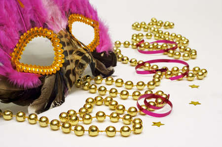 Masquerade - A Feathered Mask, Gold Beads, Star Confetti And Streamers