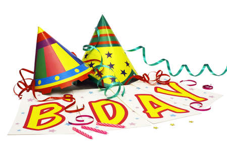 Party Hats With Streamers, A Birthday Banner and Some Candles. Isolated on white background. Stock Photo