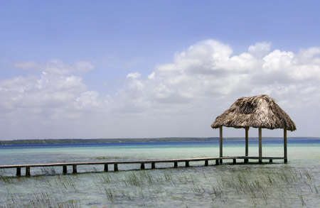 A palapa hut on the turquoise waters of Lake Bacalar, Quintana Roo, Mexico