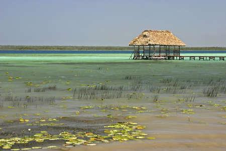 roo: A palapa hut at the end of a wooden pier at Lake Bacalar, Quintana Roo, Mexico
