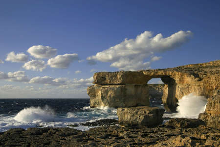 Travel attraction on Gozo Island, Malta, called the Azure Window, a natural hole in the rocky cliffs photo