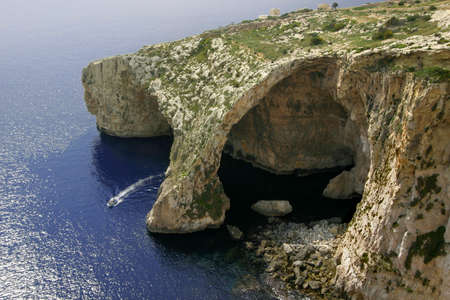 Blue Grotto, a natural rock feature on the island of Gozo, Malta