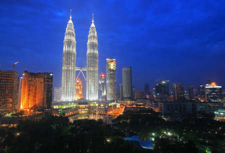 Twin Towers and the Kuala Lumpur skyline at dusk, Malaysia Editorial