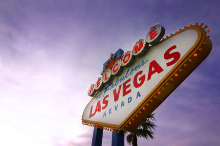 Las Vegas Welcome Sign at Sunset with space for copy on the left.