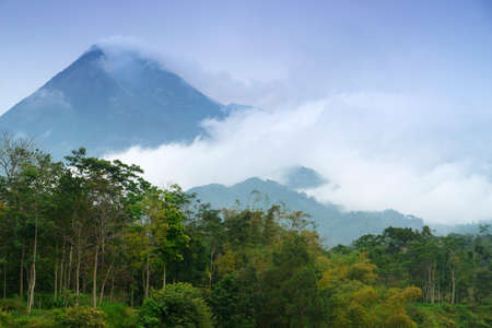 Mount Merapi-One of the worlds most active volcanoes in java, Indonesia, emitting smoke and gas from its summit. Stock Photo