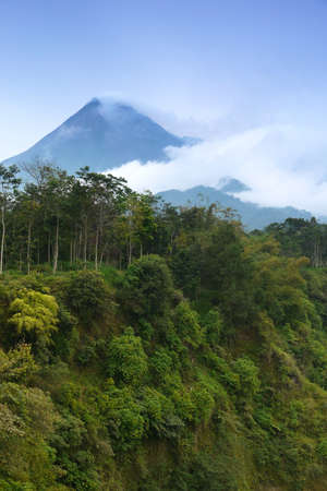java: Mount Merapi-One of the worlds most active volcanoes in java, Indonesia, emitting smoke and gas from its summit. Stock Photo