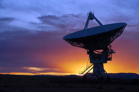 radio telescope: Silhouette of a radio telescope at the Very Large Array (VLA) in New Mexico, USA, at sunset