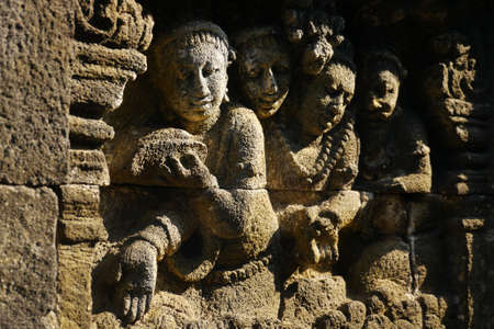 Details of the beautiful bas-reliefs made on the stone balustrade walls of the ancient temple of Borobudur, Java, Indonesia photo
